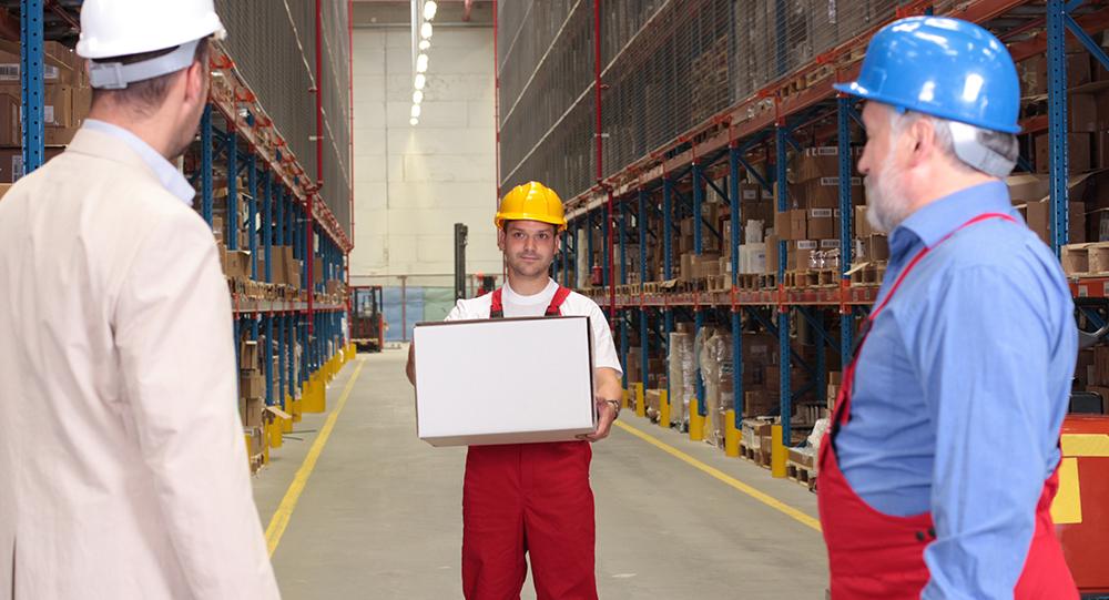 Warehouse employee lifting box at work