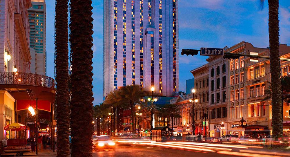 Sheraton Hotel and Bourbon St. at night