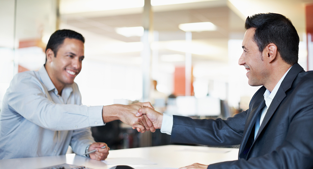 Men shaking hands after agreeing on contract